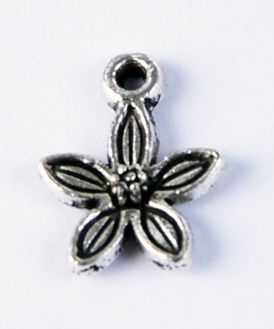Blomma berlock i tibetsilver, smyckesmaterial och silversmycken