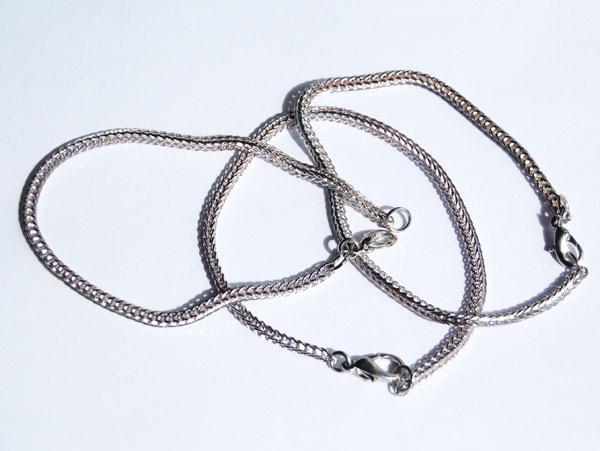 Ormlänk silver flätad modell med karbinhake lås